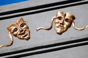 masks representing arts and entertainment newspaper